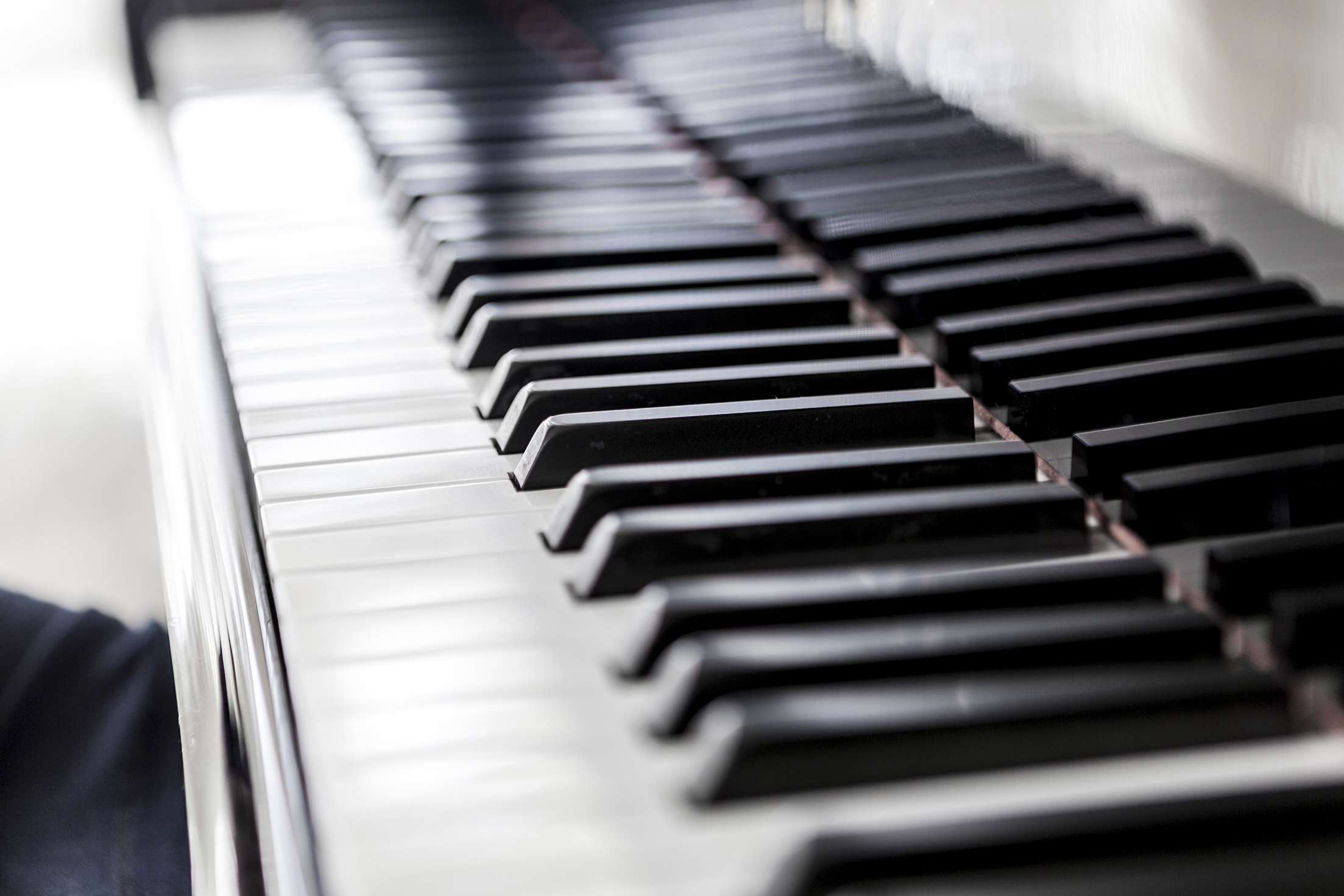Beautiful picture of a black piano and white keys